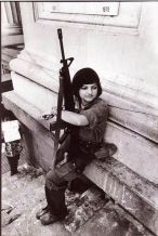 Young female soldier at Carlos Fonseca's funeral, Managua 1979